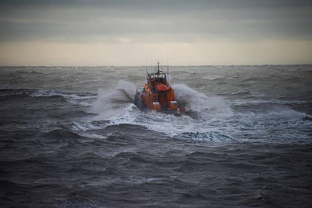 lifeboat in a storm - livbåt bildbanksfoton och bilder