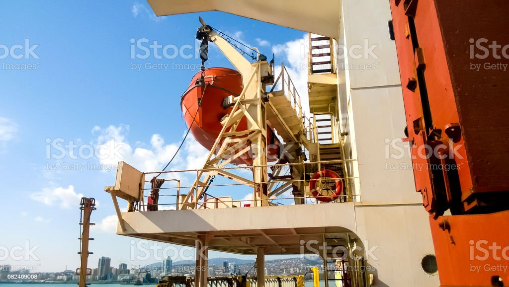 A lifeboat in case of an accident in the port or on a ship. The orange boat royalty-free stock photo