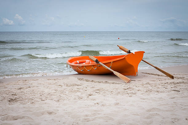 lifeboat on the baltic seashore - livbåt bildbanksfoton och bilder