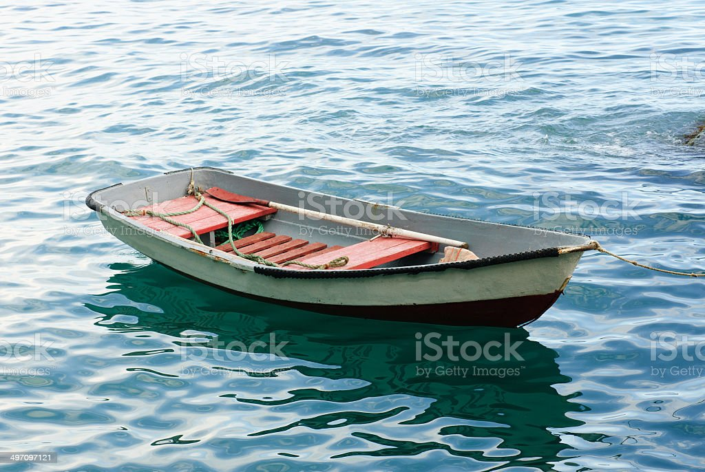 Lifeboat with paddle. Old wooden boat stock photo