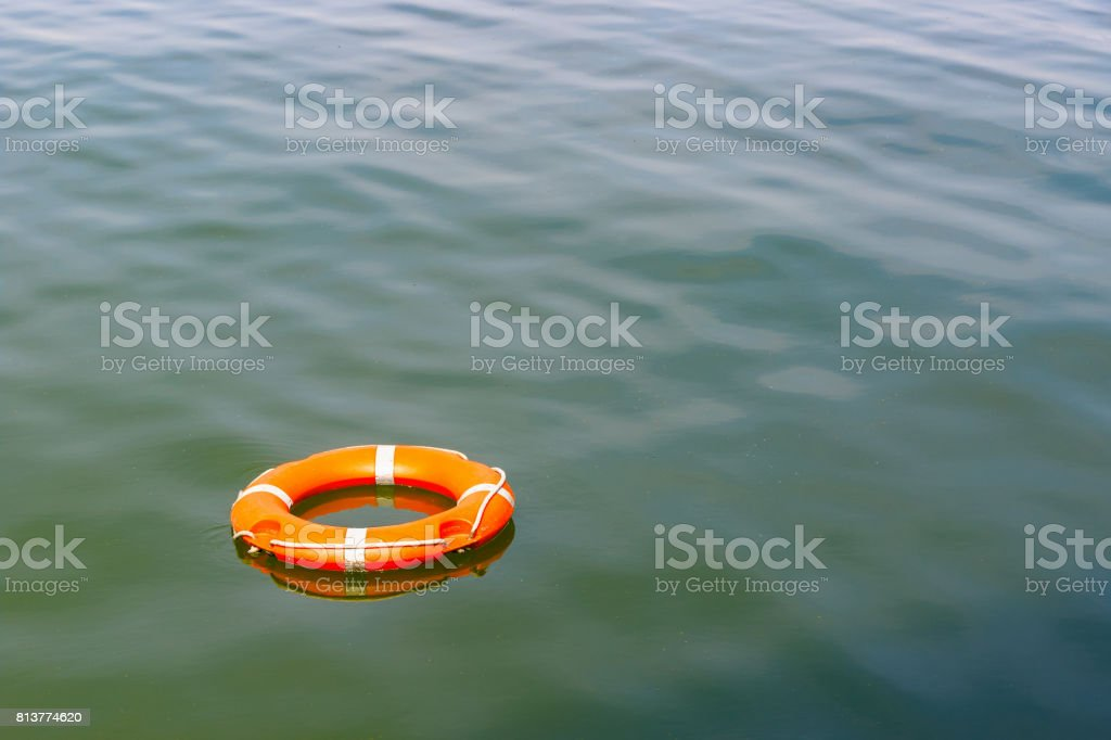 A lifebuoy floating on water stock photo