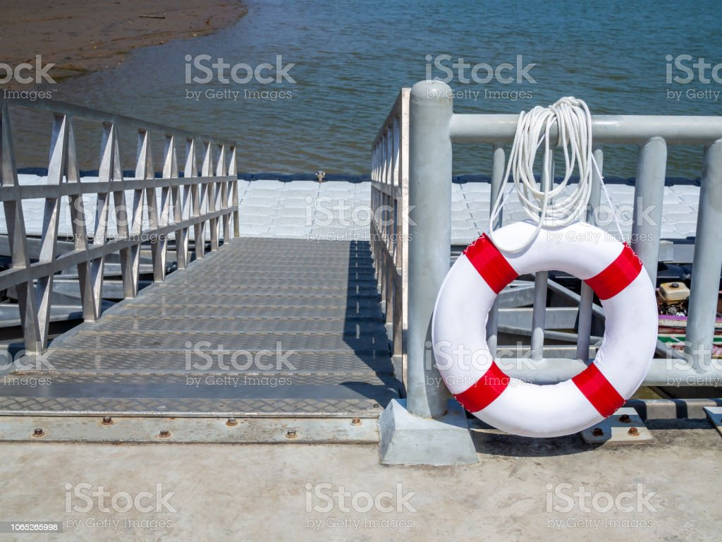 Lifebuoy hanging on the fence in the port stock photo