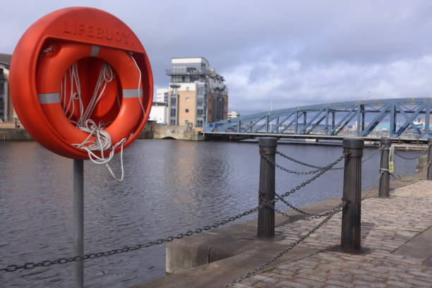 Lifebuoy hanging up by a river stock photo