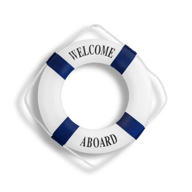 Lifebuoy, isolated on white White color life buoyancy with welcome aboard on it hanging on white concrete wall with clipping path aboard stock pictures, royalty-free photos & images