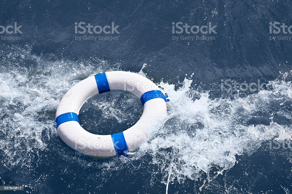 Lifebuoy, lifebelt, lifesaver in sea storm as help in danger stock photo