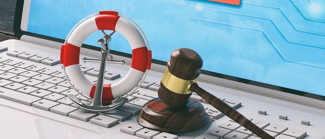 istock Lifebuoy, navy ship anchor and law gavel on computer laptop keyboard, banner. 3d illustration 1075008968