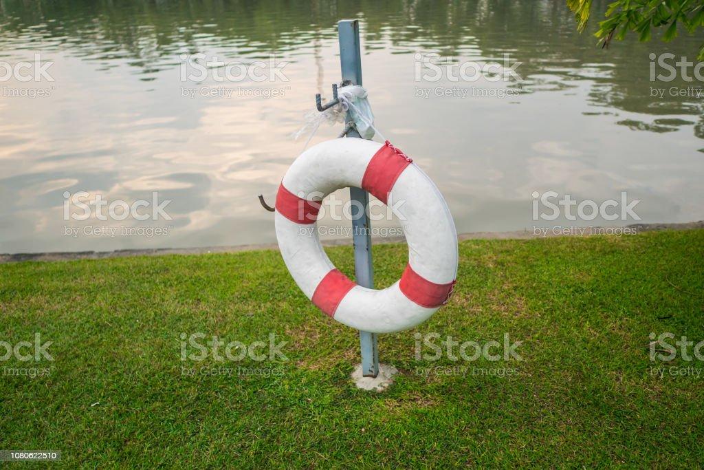 Lifebuoy near the lake stock photo