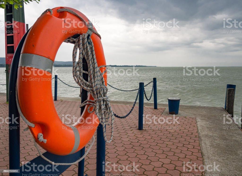 Lifebuoy on pier. Lake Balaton. Keszthely, Hungary. stock photo