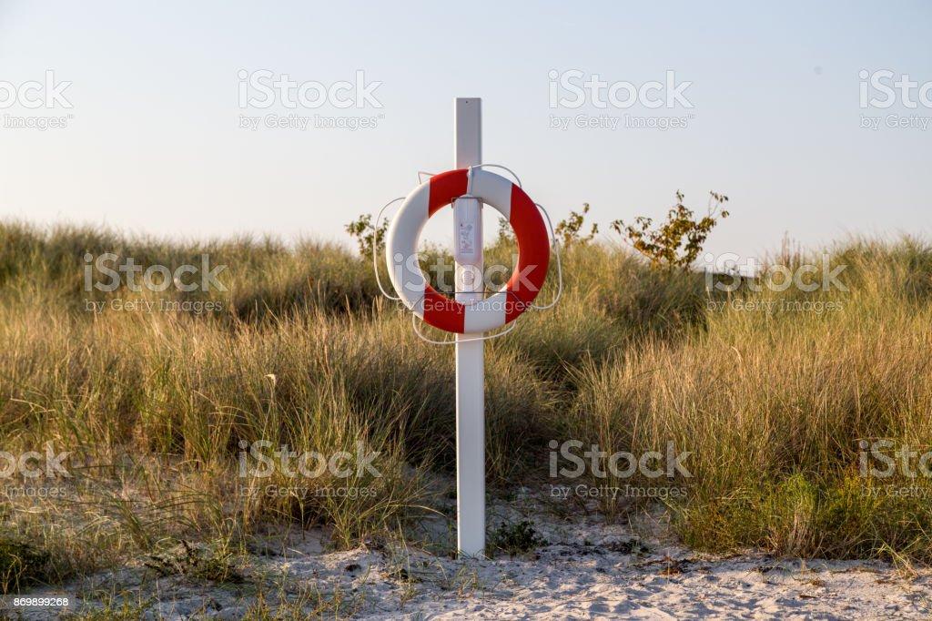 Lifebuoy on sand beach stock photo