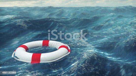 Floating lifebuoy on the wavy sea.
