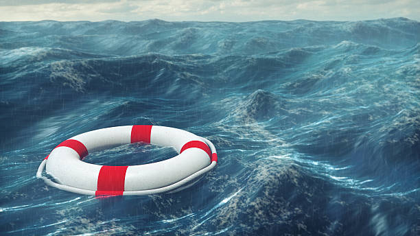Lifebuoy On The Stormy Sea Floating lifebuoy on the wavy sea. buoy stock pictures, royalty-free photos & images