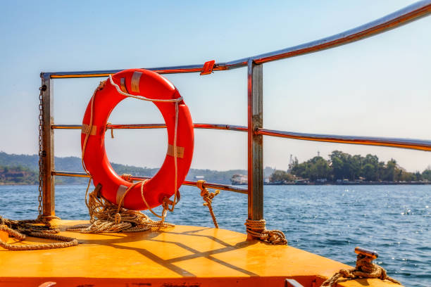 Lifebuoy railings at the front end of a tourist speed boat at Andaman sea with view of distant islands. stock photo