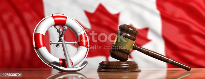 istock Lifebuoy, ship anchor and justice gavel on Canadian flag background, banner. 3d illustration 1075008704