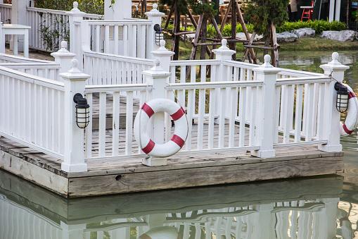istock Lifebuoys on Wooden fence 496705898