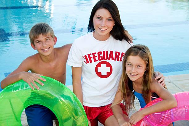 Lifeguard And Children stock photo