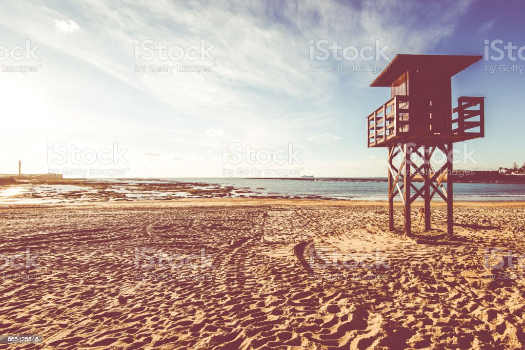 Lifeguard baywatch tower on the sandy beach stock photo