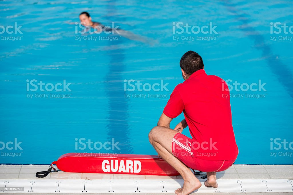 Lifeguard by the pool stock photo