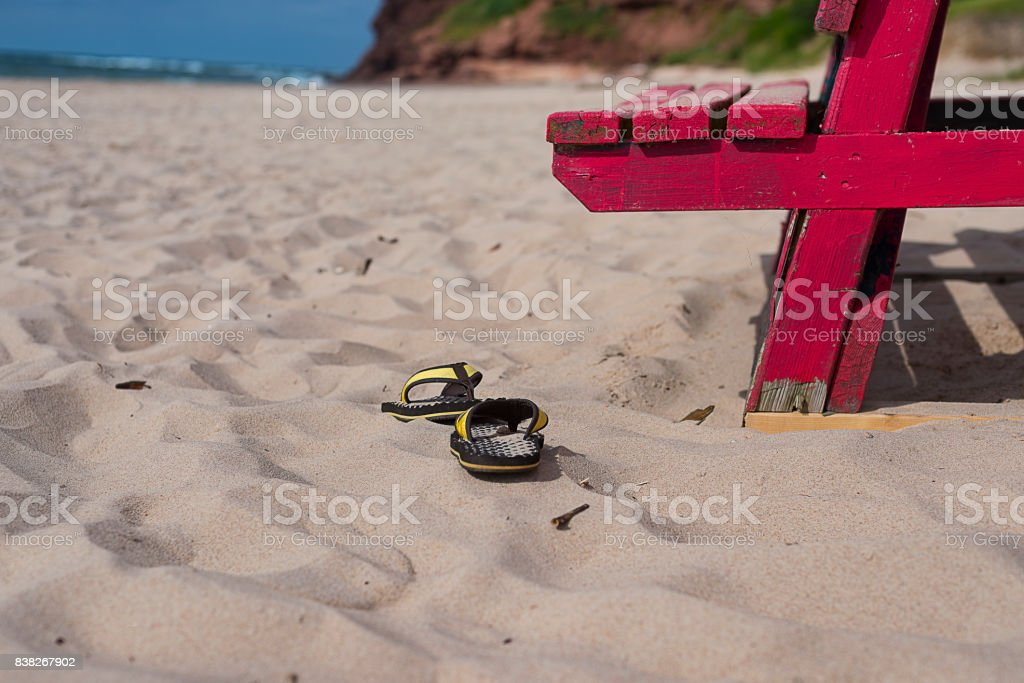 Lifeguard chair and Beach sandals stock photo
