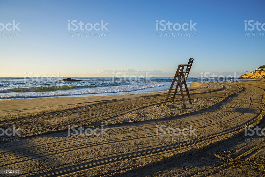 Lifeguard chair on empty beach royalty-free stock photo