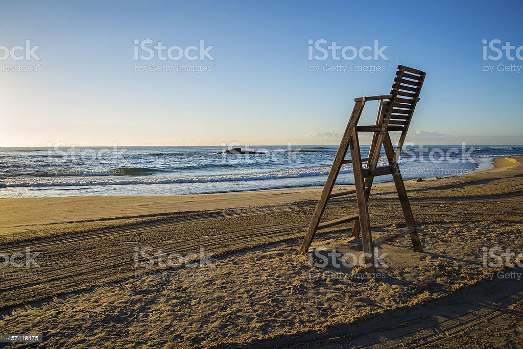 Lifeguard chair on empty beach stock photo