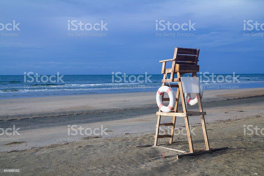 Lifeguard chair on stormy beach stock photo
