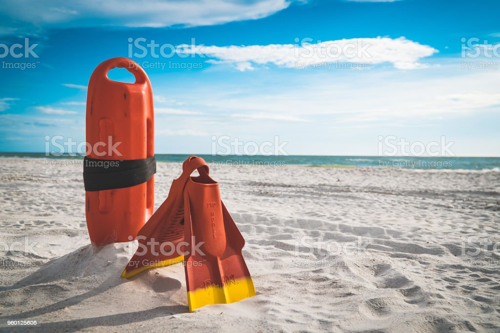 Lifeguard equipment in the sand stock photo