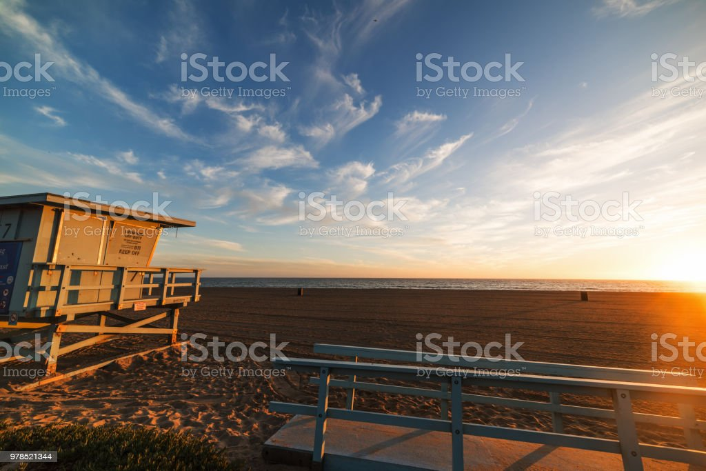 Lifeguard hut on the sand In Santa Monica beach at sunset stock photo
