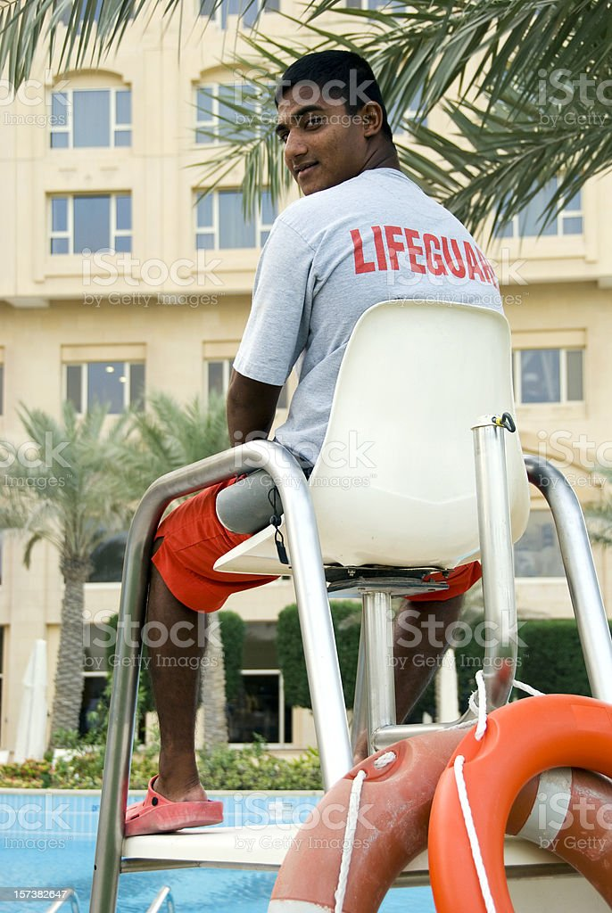 Lifeguard looking at camera royalty-free stock photo