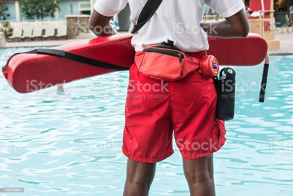 Lifeguard Looking Out Over Pool stock photo