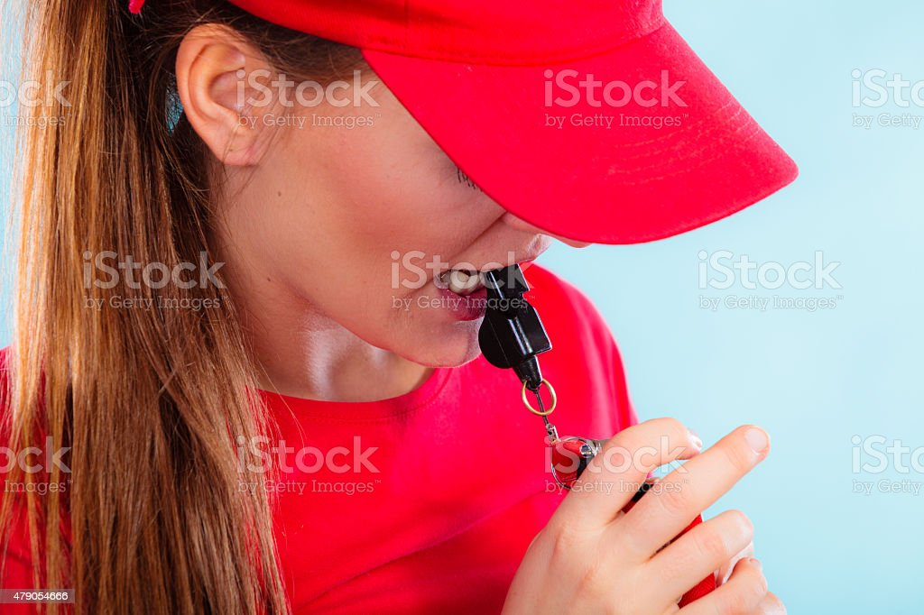 lifeguard on duty blowing a whistle stock photo