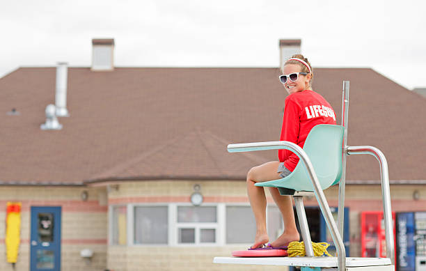 Lifeguard on Duty Female lifeguard at work lifeguard stock pictures, royalty-free photos & images
