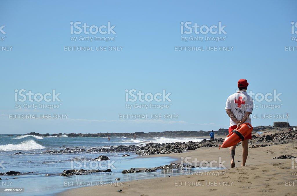 Lifeguard patrolling the beach stock photo