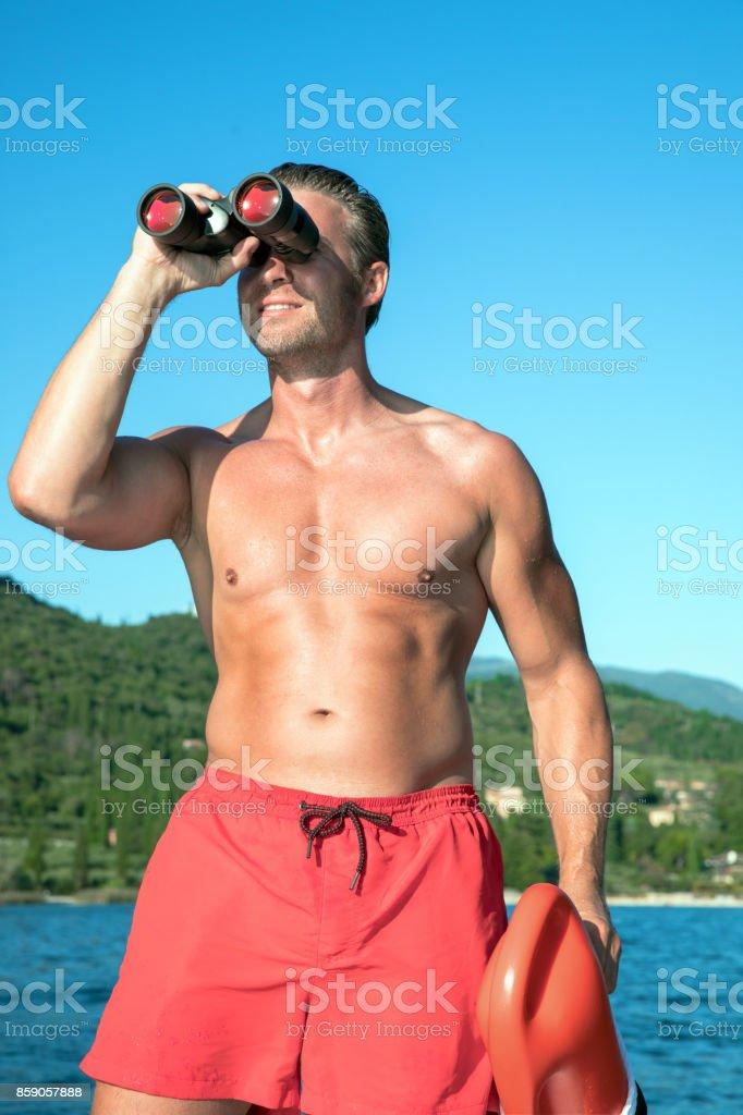 ein paar Tage entfernt glatt für die ganze Familie Bademeisterrettungsschwimmer Stockfoto und mehr Bilder von ...
