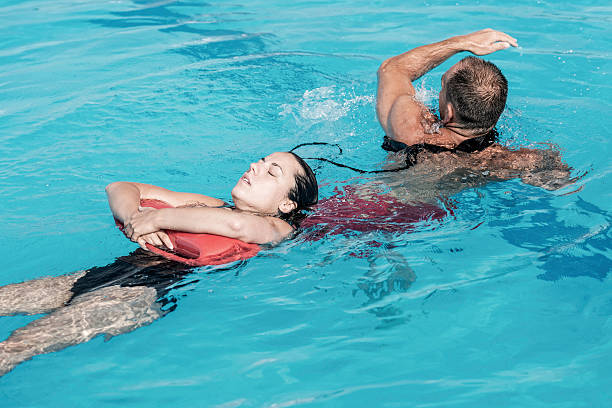 Lifeguard rescue training Lifeguard in training, rescuing victim from water lifeguard stock pictures, royalty-free photos & images