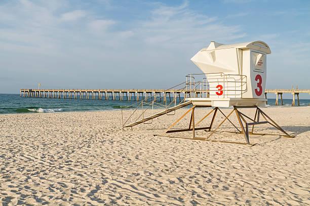 lifeguard station and pier on pensacola beach - badvaktshytt bildbanksfoton och bilder