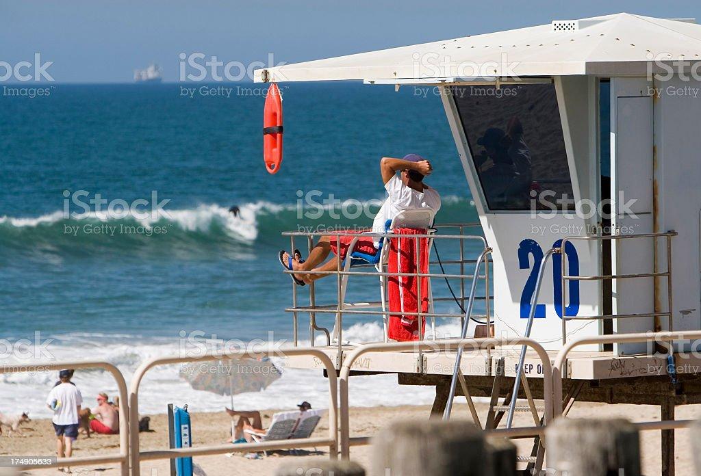 Lifeguard takes watch. stock photo