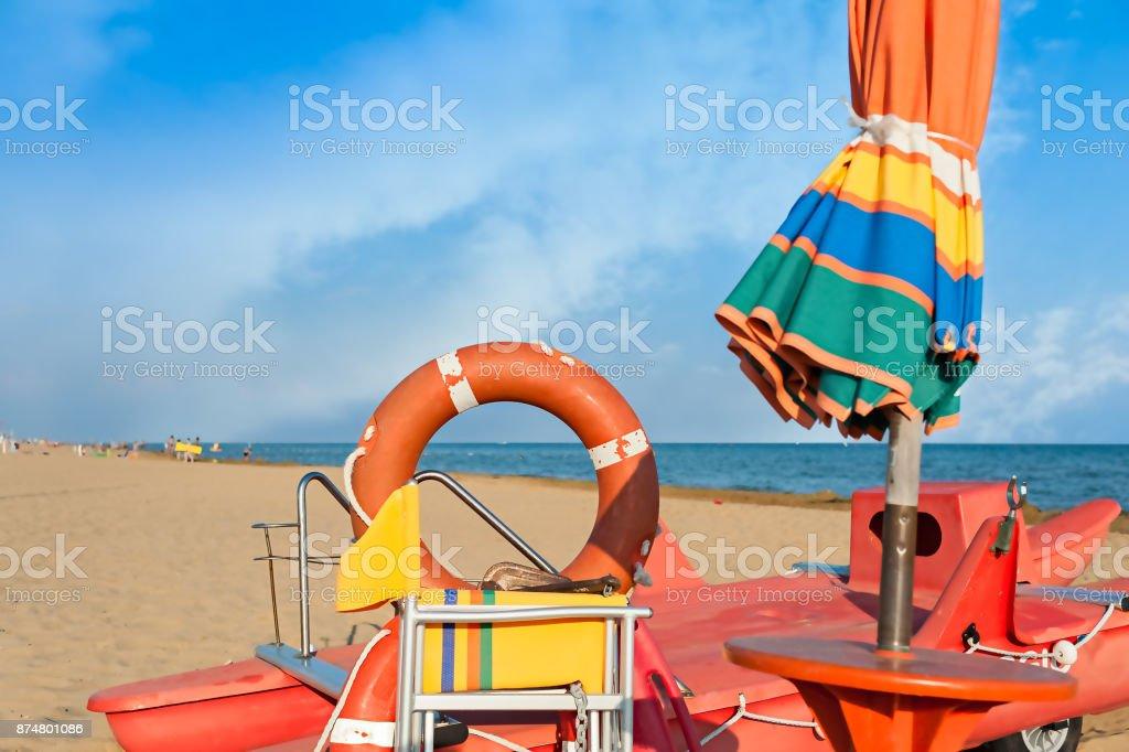 Lifeguard tools, umbrella,lifebuoy and rescue boat. stock photo