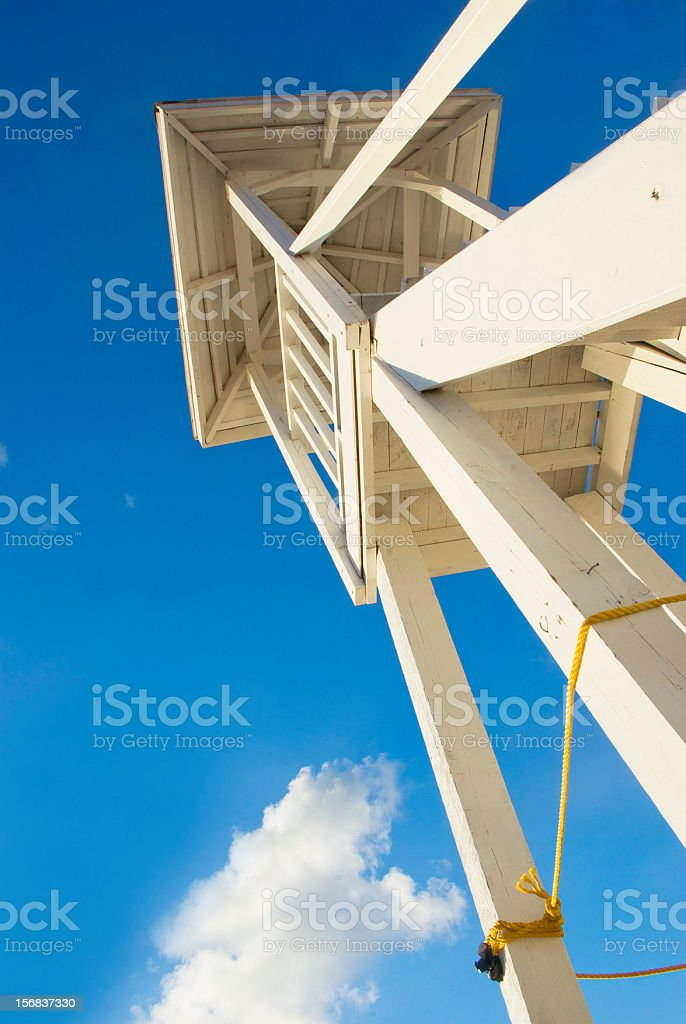 lifeguard tower against blue sky stock photo