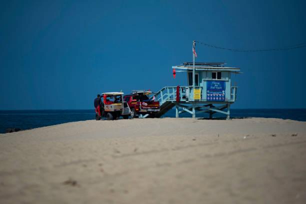 Lifeguard Tower and vehicles on Venice Beach, Santa Monica, California stock photo
