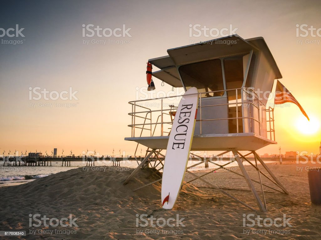 Lifeguard tower at sunset near pier in Long Beach, CA stock photo