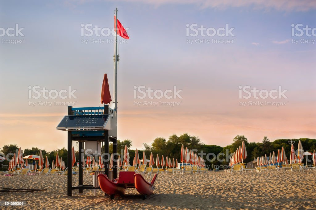 Lifeguard tower on a beach with rescue boat. stock photo