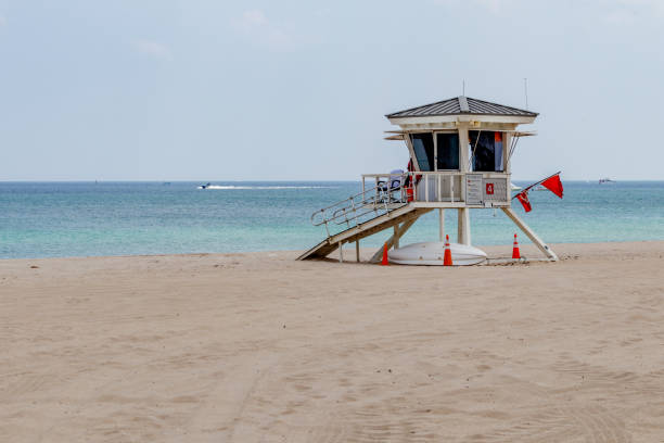 Lifeguard tower on a closed beach with motor boat stock photo