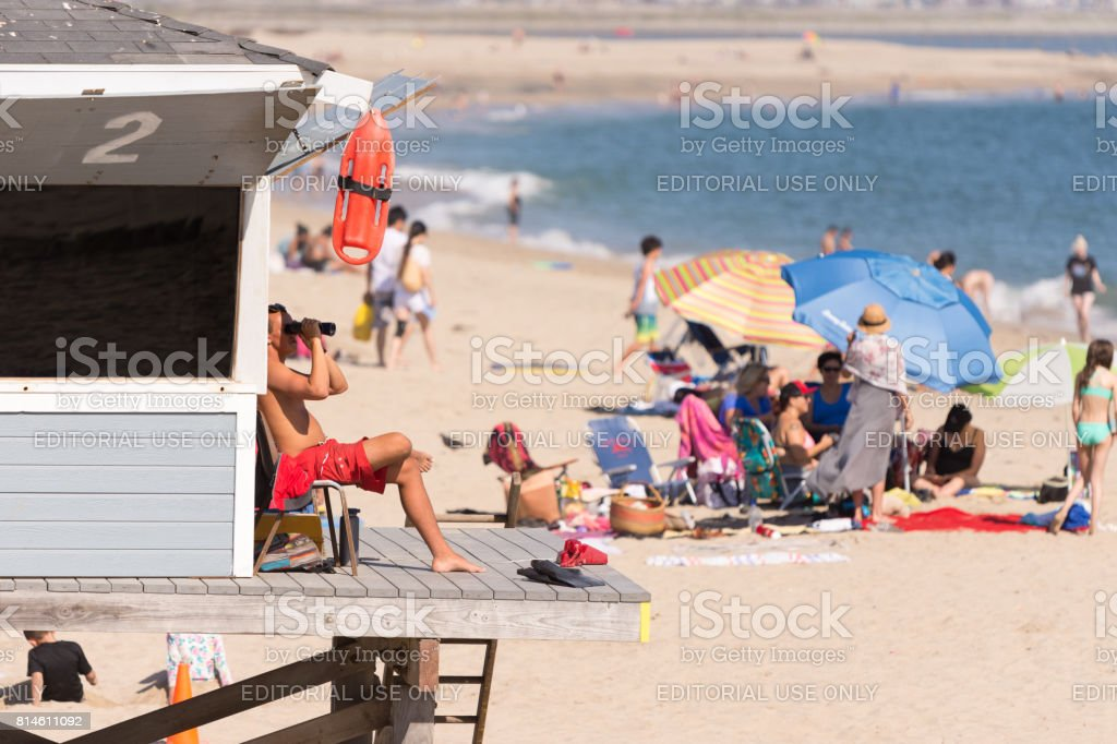 Lifeguard watches from tower in Seal Beach, CA stock photo