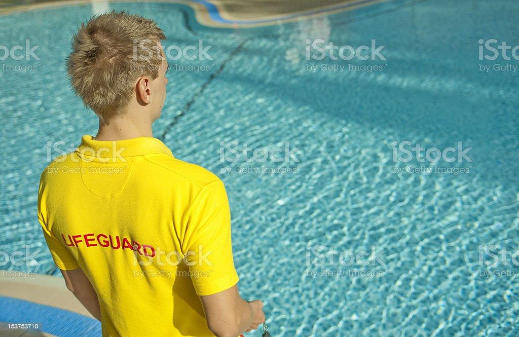 Lifeguard watching an empty swimming pool royalty-free stock photo