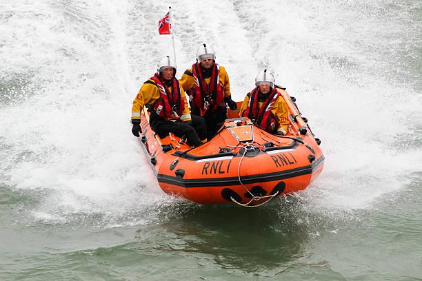 rnli lifeguards in action - livbåt bildbanksfoton och bilder