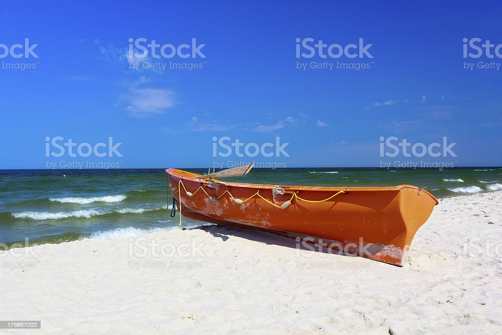 Lifeguard's rescue boat on the beach royalty-free stock photo