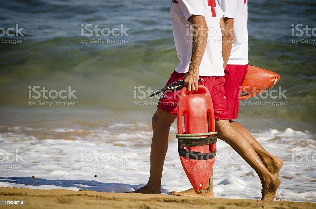 Lifeguards walking on the beach stock photo