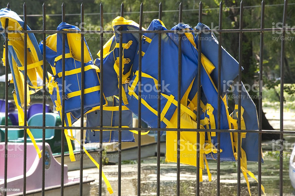 Lifejackets Hanging to Dry at a Paddle Boat Rental Venue royalty-free stock photo