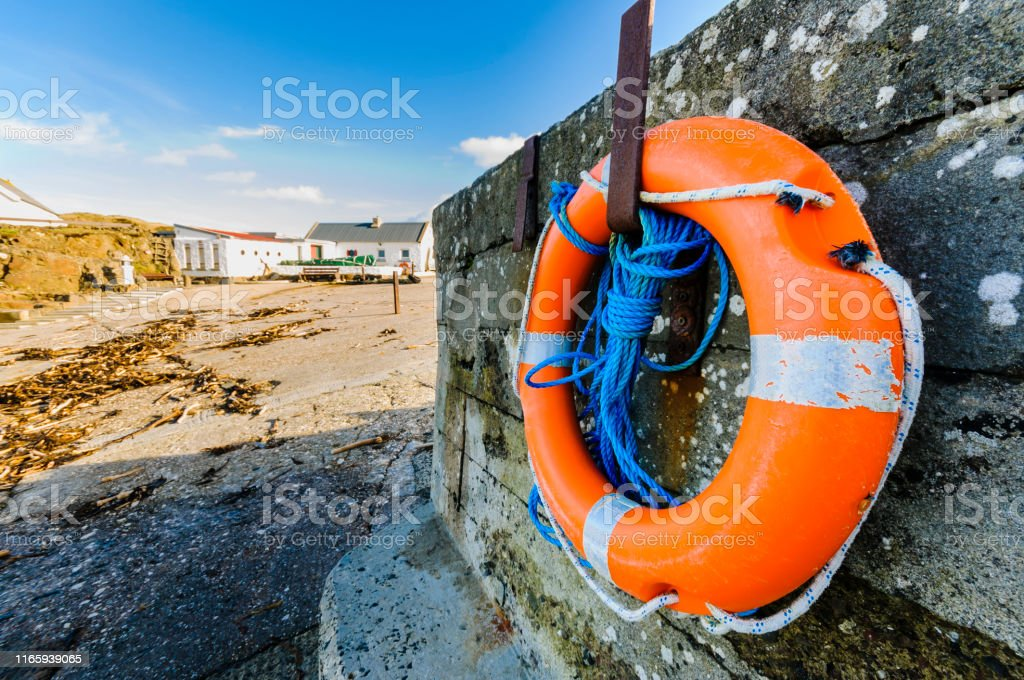 Lifering on a harbour wall