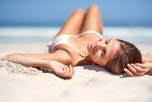Shot of an attractive young woman lying on the beach in a bikinihttp://195.154.178.81/DATA/i_collage/pi/shoots/806160.jpg